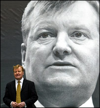 Charles Kennedy in front of election poster