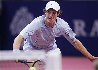 Murray rushes into the net and his efforts pay off as he defeats his childhood idol
