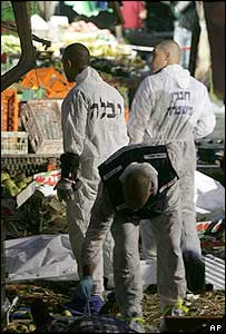 Israeli police inspect the site of the suicide bomb attack in Hadera