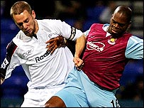 Bolton's Kevin Nolan (left) tussles with West Ham's Marlon Harewood