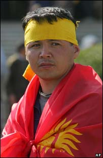 Kyrgyz protester wrapped in a national flag