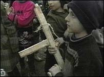 Chechen child with wooden AK-47