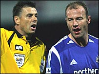 Alan Shearer shows his cut lip to referee Mark Halsey