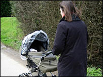 Mother pushing a pram