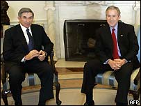 Paul Wolfowitz (l) and George W Bush