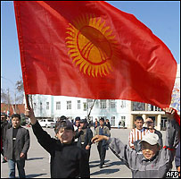 Young Kyrgyz opposition supporter wave the National Kyrgyz flag in Osh, southern Kyrgyzstan, 22 March 2005.