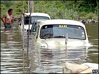 Cars lying submerged in floodwater following heavy rains in Tamil Nadu