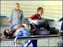 An Iraqi policeman is taken to hospital in Baquba