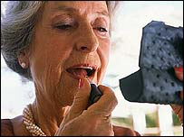 Elderly woman applying lipstick (generic image)