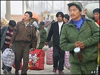 Men from rural China arriving in Beijing to look for work