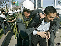 Kyrgyz policemen arrest opposition supporters in downtown Bishkek, Kyrgyzstan, Wednesday, March 23, 2005