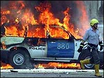 A police car on fire after an attack by insurgents in Iraq