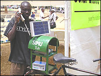A man on a solar powered telephone in Kenya