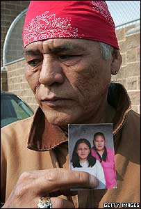 Orville White holds a photograph of his niece Thurlene Stillday (in pink), who was killed in the Red Lake shooting