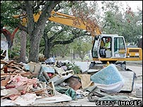 Workers clean debris from a home near Lake Ponchartrain during the clean-up following Hurricane Katrina