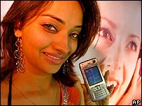 Indian woman holding mobile phone