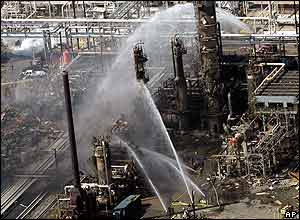 Firefighters douse flames at the refinery