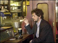 Man drinks Guinness in a pub