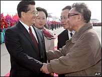 China's Hu Jintao (left) is greeted by Kim Jong-il - 28/10/05
