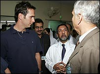 Michael Vaughan talks to a doctor at the Pakistan Institute for Medical Science