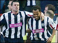 West Brom's Robert Earnshaw is congratulated