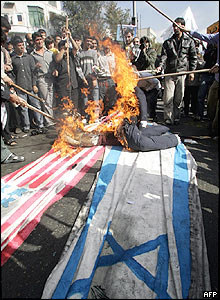 Burning US and Israeli flags