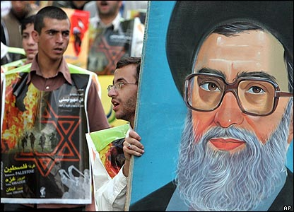 Protester holds a portrait of Iran's supreme leader Ayatollah Ali Khamenei