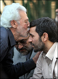 Mahmoud Ahmadinejad is kissed by an Iranian man