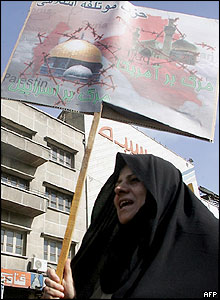 Woman protester holds an anti-Israel placard