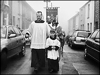 A Rhodri Jones picture of a religious procession through Blaenafon