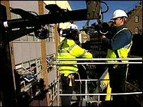 Workmen installing the microwave transceivers
