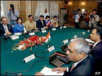 The Pakistani and Indian delegations at the talks in Islamabad