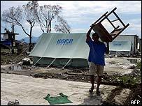 Aceh survivor outside UNHCR tent