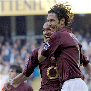 Robert Pires (R) is congratulated by Gael Clichy