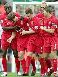 Xabi Alonso (second left) is congratulated by his Liverpool team-mates after putting them ahead against West Ham