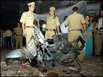 Indian police survey the blast scene
