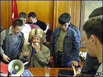Kyrgyz opposition supporters gather in President Askar Akayev's office in Bishkek, Kyrgyzstan, Thursday, March 24, 2005.