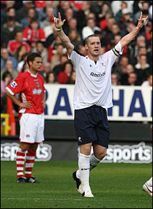 Kevin Nolan salutes the travelling Bolton fans