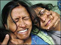 Women grieve the after the death of a family member