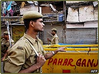 Police stand guard at site in Paharganj area of Delhi