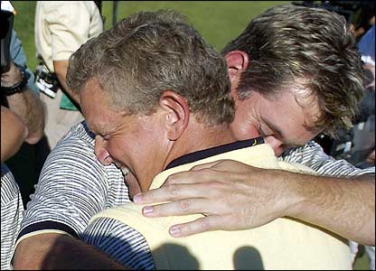 Colin Montgomerie is embraced by Lee Westwood after holing the winning putt
