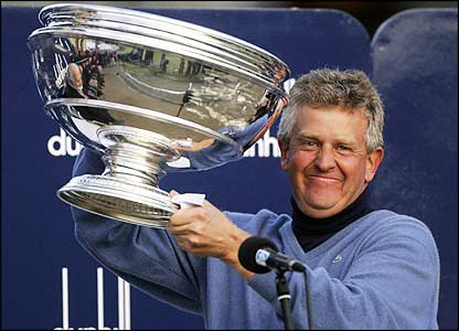 Colin Montgomerie poses with the Dunhill Links Championship trophy