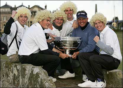 Colin Montgomerie poses with some of his fans and the Dunhill Links Championship trophy