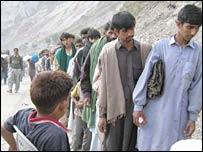 A queue of quake survivors