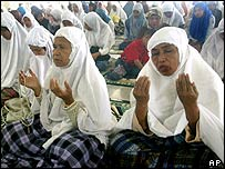 Women from Aceh praying for the tsunami victims in February