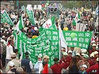 Protesters march in defiance of Beijing's anti-secession law in Taipei
