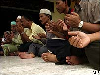 Muslims at prayer in a Kuala Lumpur mosque