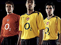 O2's logo emblazoned on the shirts of Arsenal football players (from right) Jens Lehmann, Thierry Henry and Francesc Fabregas