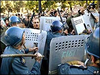 Riot police and protesters clash in Baku