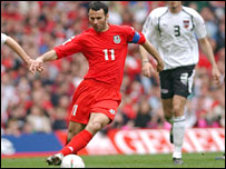 Ryan Giggs runs at the Austrian defence
